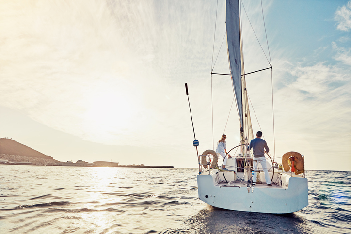 Shot of a couple out sailing on a yacht